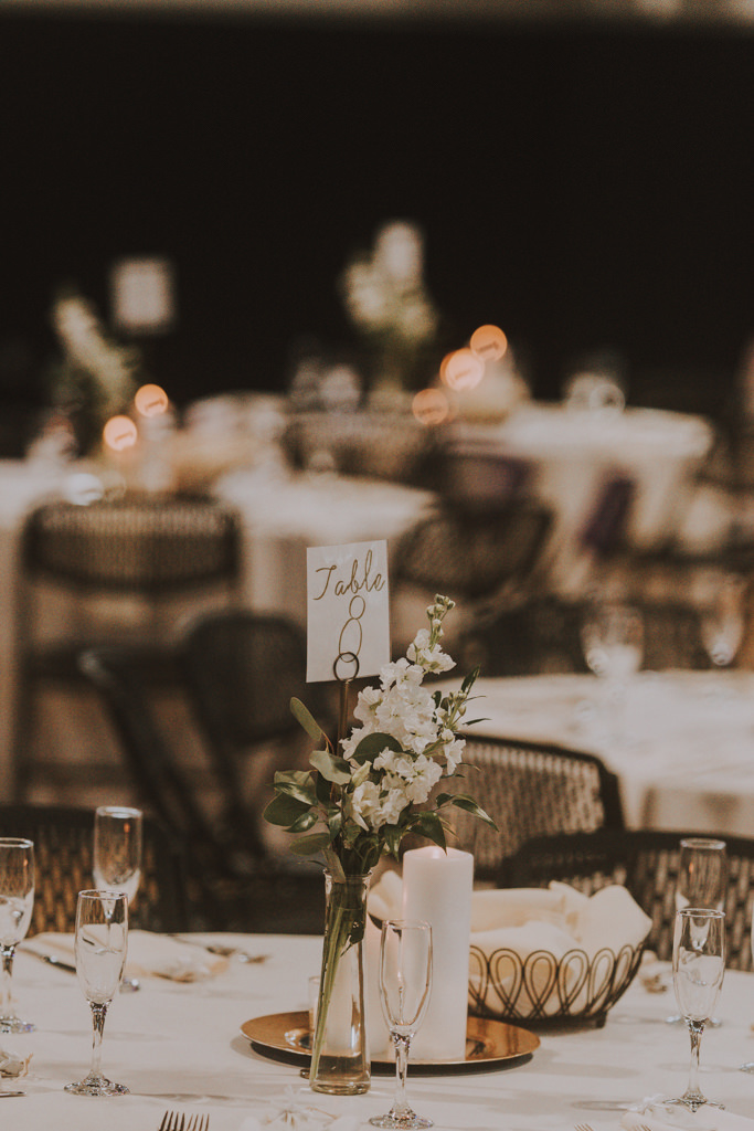 Simple Wedding Reception Centerpiece with Bud Vase of White Flowers and Greenery and Candles | Table Number Pick Holders in Vases