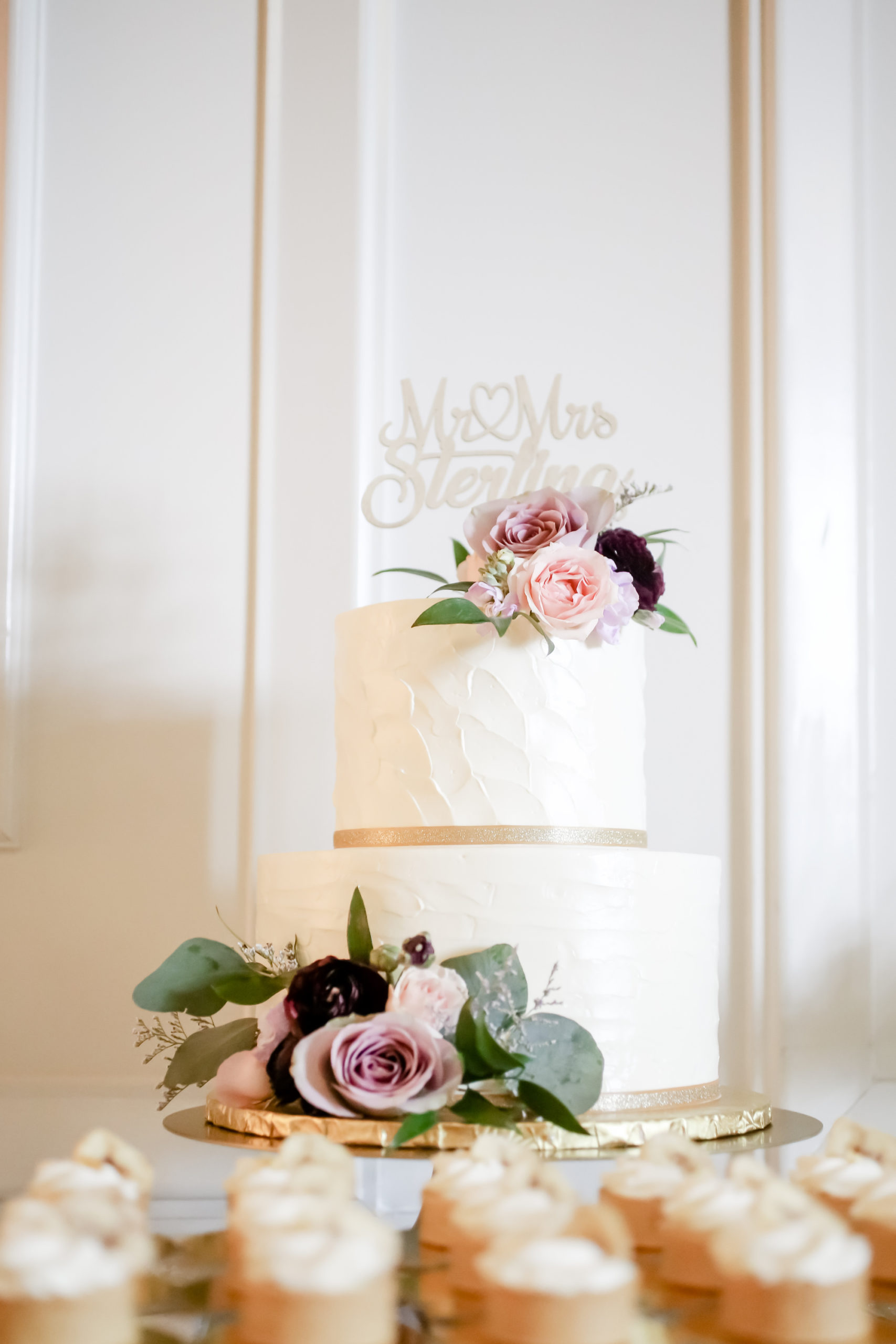 Elegant Spring Time Inspired Wedding Cake, Classic White Two Tier Buttercream Cake with Textured Frosting, Purple, Pink and Mauve Rose Floral Accents with Custom Cake Topper and Dessert Table   Tampa Bay Wedding Cake and Dessert Bakery The Artistic Whisk   Florida Wedding Photographer Lifelong Photography Studio   St. Pete Wedding Planner Blue Skies Weddings and Events