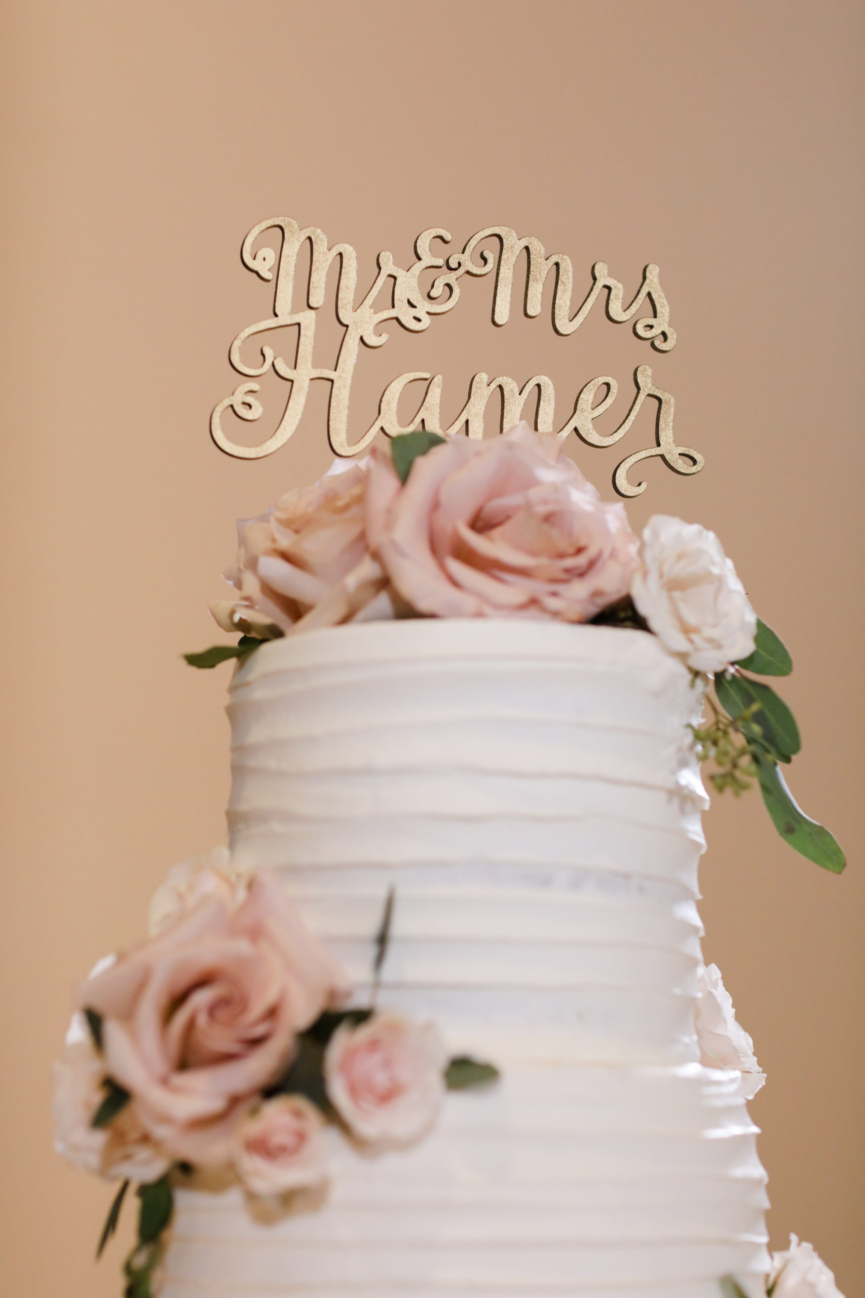 Ribbed Textured Buttercream Wedding Cake with Fresh Flowers Rusty Rose and Calligraphy Gold Cake Topper