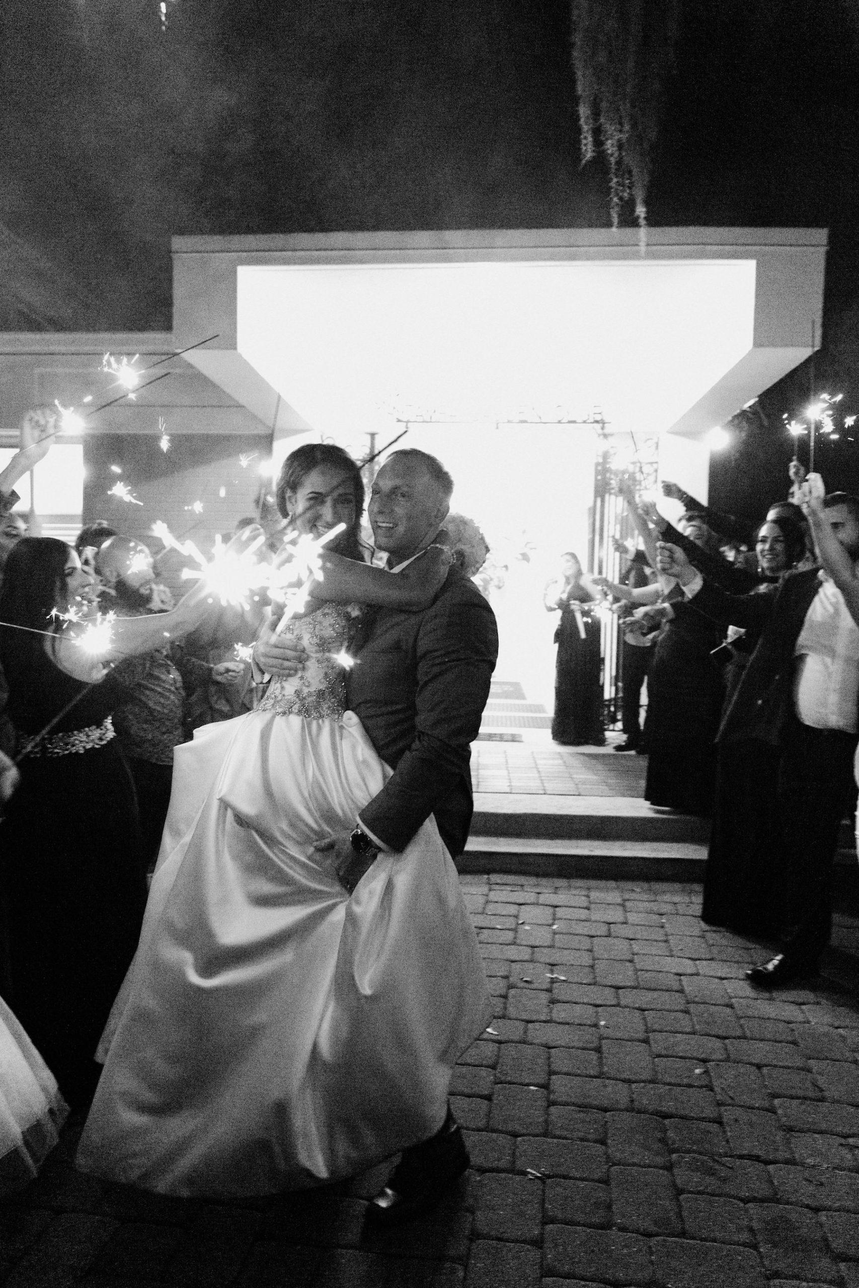 Black and White Bride and Groom Sparkler Exit Wedding Portrait | Wedding Venue Tampa Garden Club | Wedding Photographer Shauna and Jordon Photography | Wedding Dress Truly Forever Bridal