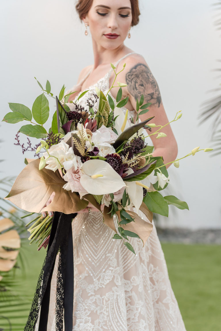 Dark Luxe, Romantic Styled Wedding Shoot, Bride in Beaded Lace with Nude Lining Holding White Cala Lilly, Blush Pink Roses, Gold Palm Leaves, Greenery, and Purple Flowers Bouquet | Tampa Bay Wedding Planner Elegant Affairs by Design