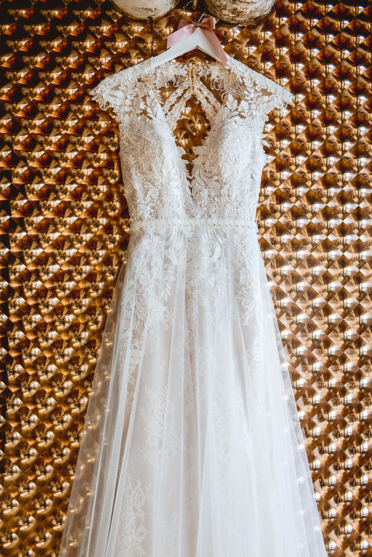 Wedding Dress Hanger Shot | Ivory Lace and Tulle A Line Bridal Gown with Illusion Lace Cap Sleeve and Keyhole Open Back