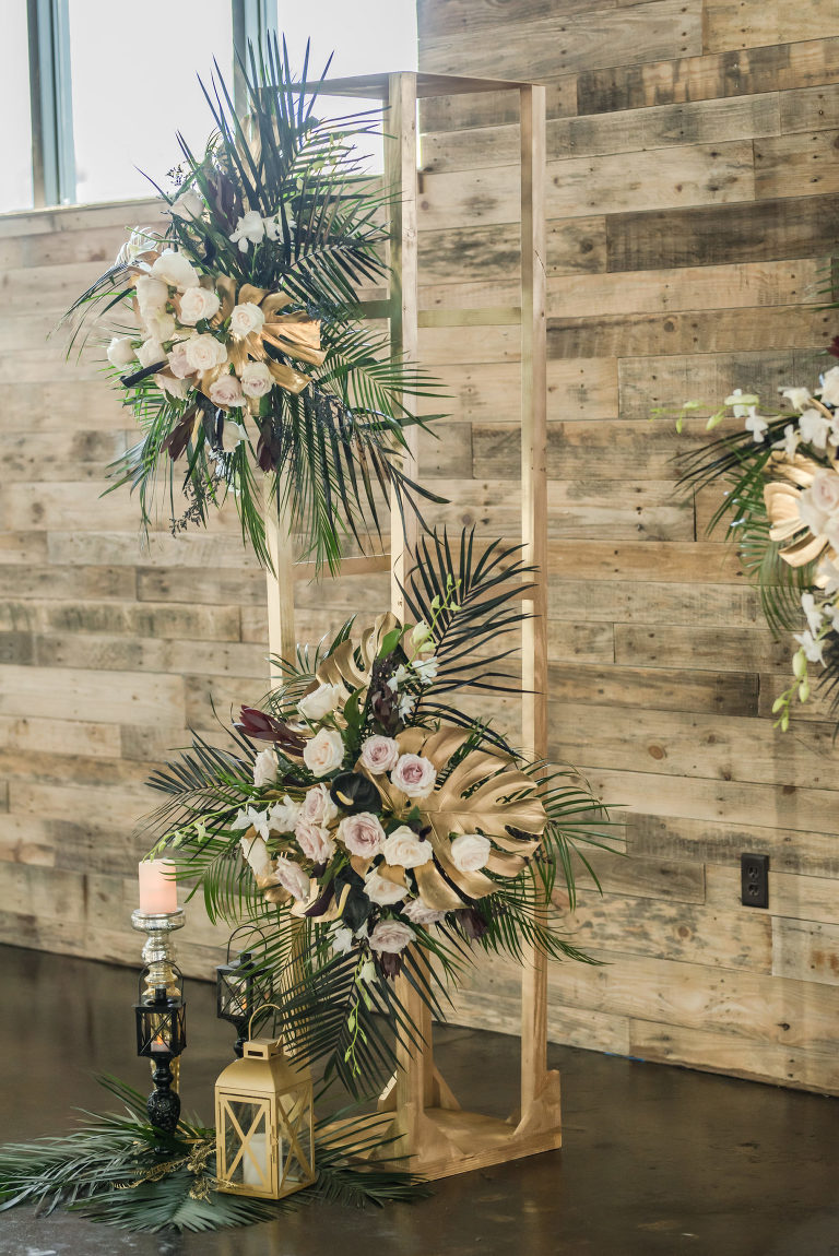 Dark Luxe, Romantic Wedding Styled Shoot, Tall Gold Geometric Stand with White and Blush Pink Roses, Palm Fronds and Gold Monstera Leaves, Gold Lantern | Tampa Bay Wedding Planner Elegant Affairs by Design | Madeira Beach Wedding Venue The West Events Sapce