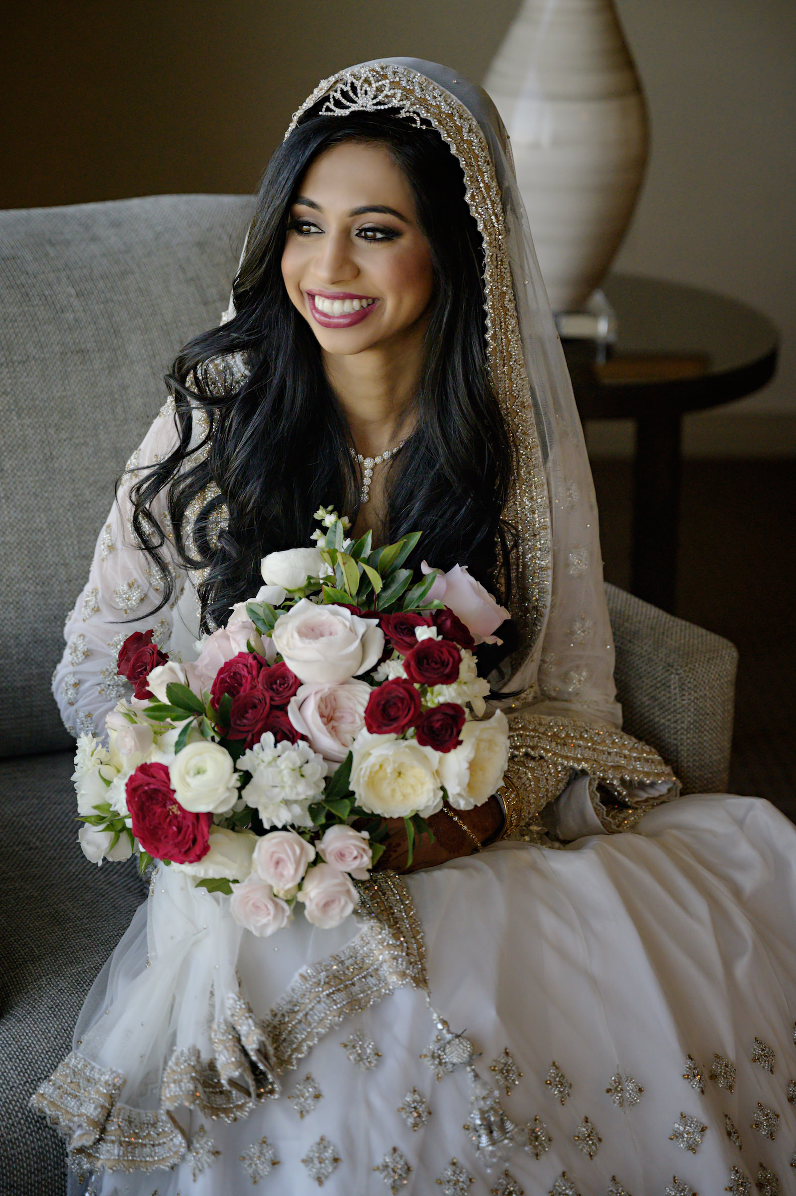 Florida Indian Bridal Portrait, Tampa Bay Bride in MultiCultural Fusion Wedding Dress, White and Gold Veil, Holding Romantic Bouquet with Red, Pink, and Ivory Roses Floral Bouquet | Florida Indian Wedding Hair and Makeup Artist Michele Renee The Studio