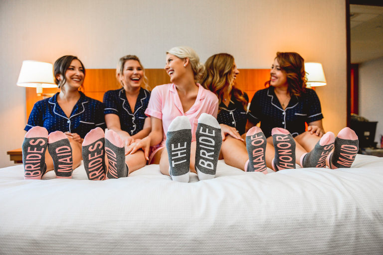 Bride and Bridesmaids Getting Ready in Pajamas with Custom Wedding Party Socks