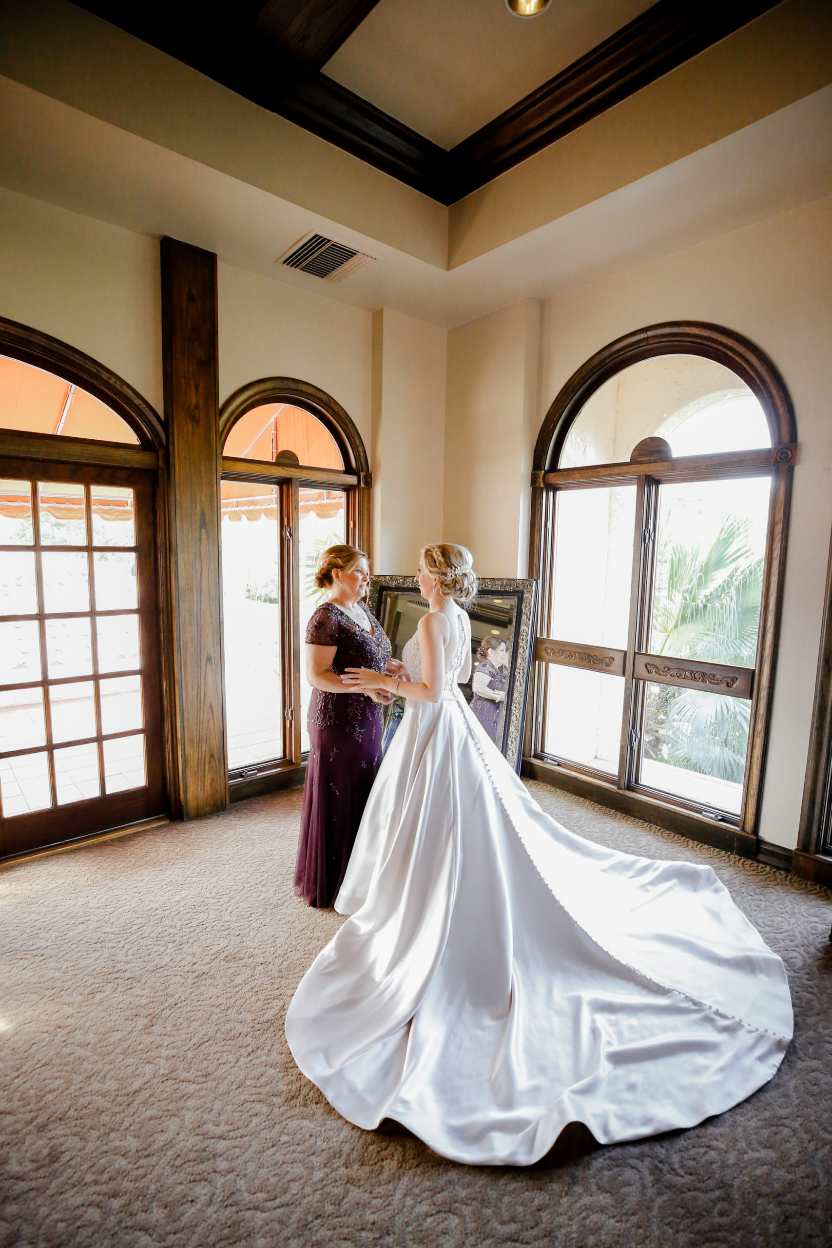 Bride and Mom First Look Wedding Portrait | White Allure Ballgown Wedding Dress with Long Train
