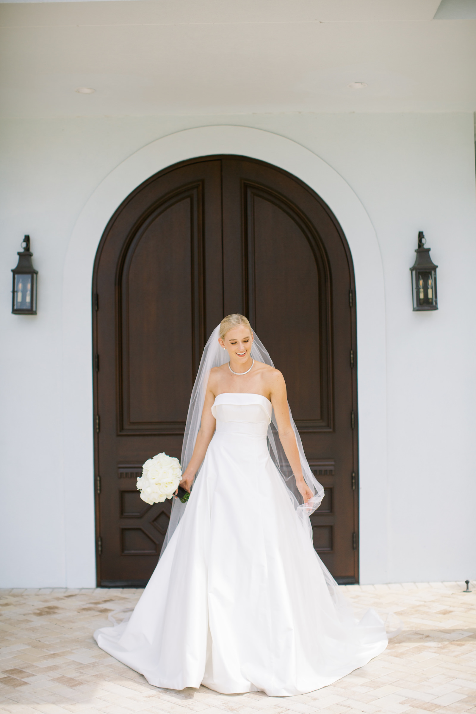 Tampa Bride in Strapless Ballgown Crepe Romona Keveza Wedding Dress Holding Classic White Floral Bouquet | Safety Harbor Wedding Venue Harborside Chapel