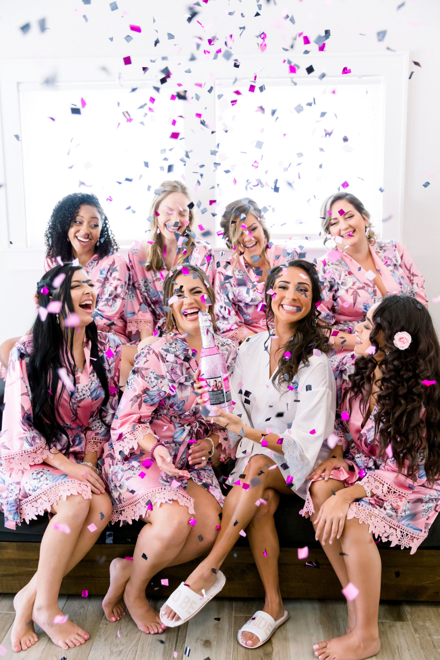 Fun Pink and Gray Confetti Portrait with Bride and Bridesmaids in Matching Pink Floral Robes and Champagne | Tampa Bay Wedding Photographer Shauna and Jordon Photography