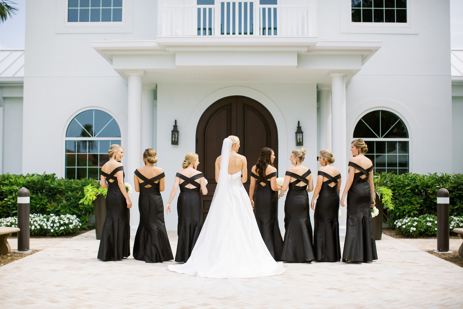 Classic Tampa Bride with Bridesmaids in Matching Crossback Black Dresses | Safety Harbor Traditional Wedding Venue Harborside Chapel