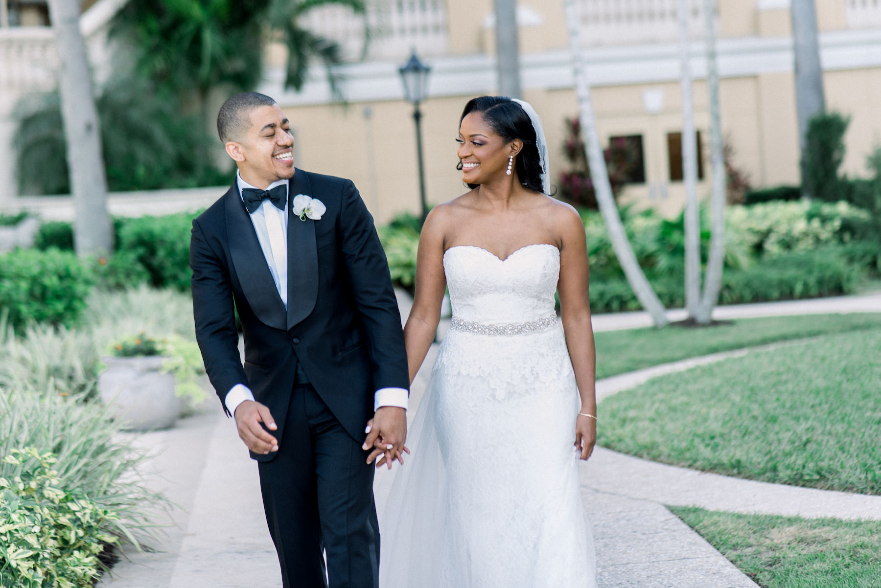 Florida Classic Bride in Lace Strapless and Sweetheart Neck Line with Rhinestone Belt Wedding Dress and Groom in Black Tuxedo Portrait