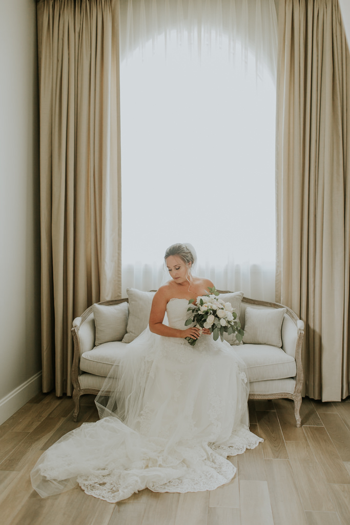 Bride Portrait in the Bridal Suite | Lace Martina Liana Wedding Gown with Long Cathedral Veil | Greenery and White Flowers Bride Bouquet | Harborside Chapel Bridal Suite