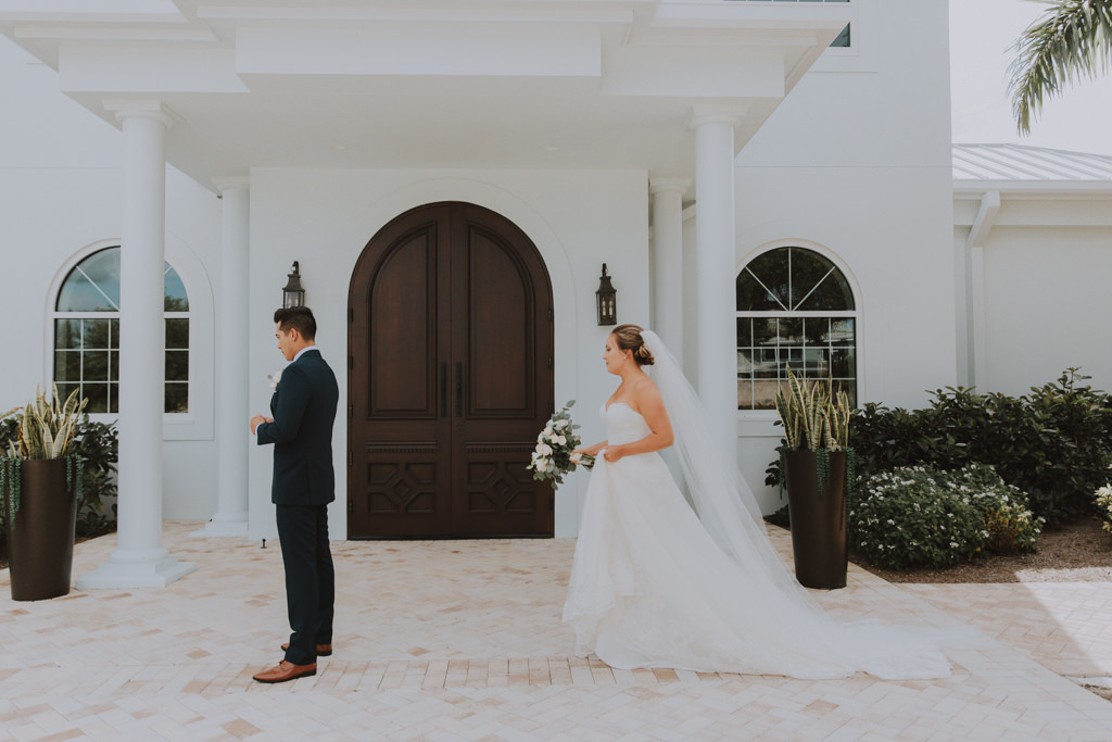 Bride and Groom First Look | Clearwater Wedding Venue Harborside Chapel | Groom Classic Black Tux | Lace Wedding Gown with Long Cathedral Veil