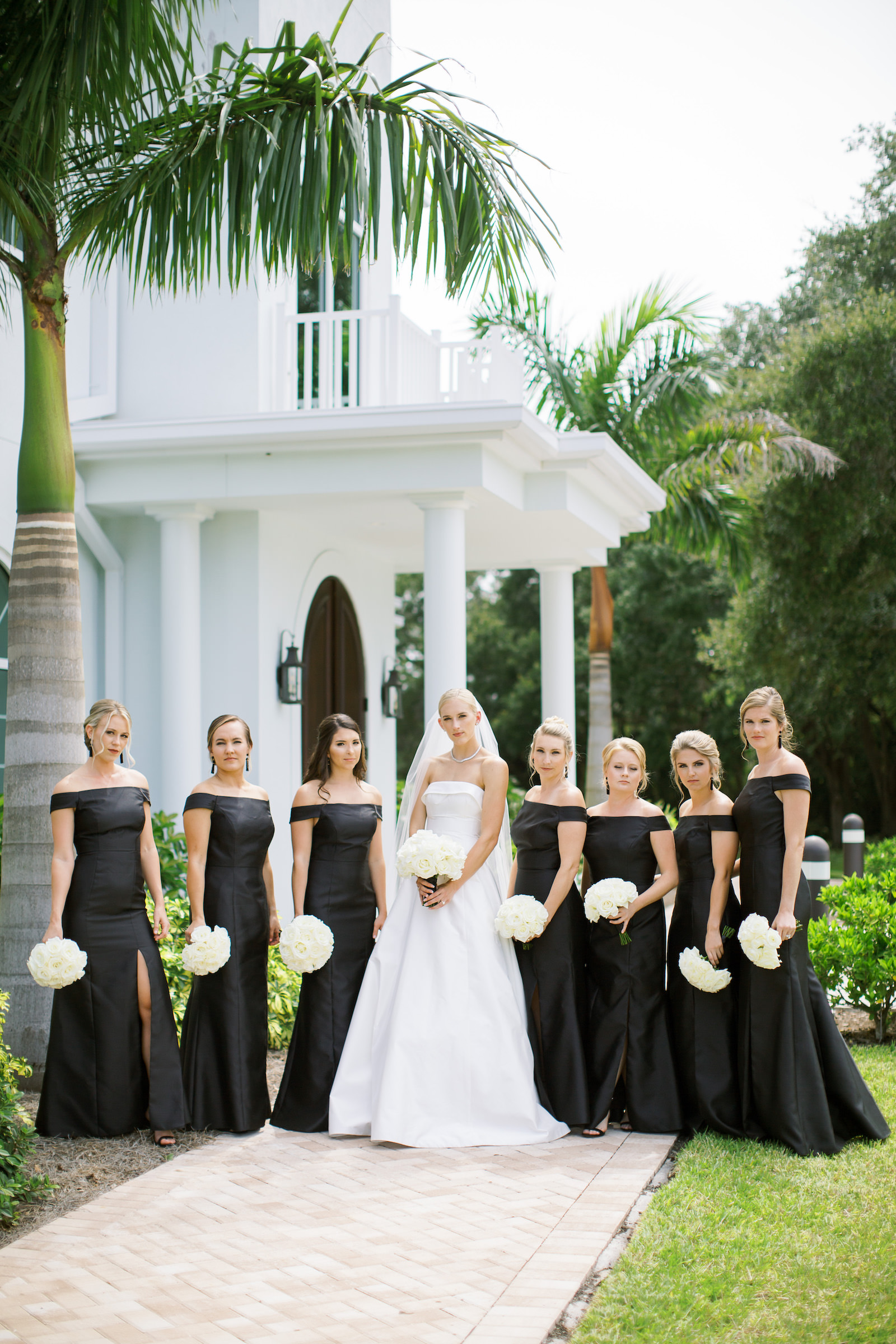 Classic Tampa Bride with Bridesmaids in Matching Off the Shoulder Dresses Holding White Floral Bouquets | Safety Harbor Traditional Church Wedding Venue Harborside Chapel
