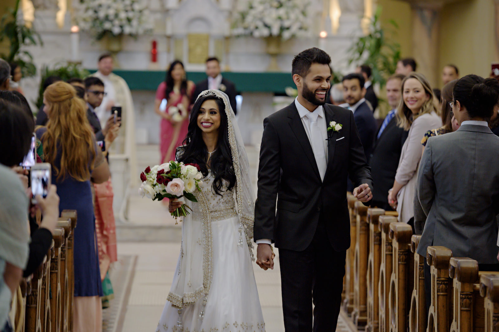 Indian Tampa Bay Bride and Groom Walking Down the Aisle | Indian Catholic Wedding | Florida Multicultural Wedding Ceremony | Catholic Wedding Ceremony at Sacred Heart Catholic Church | Wedding Hair and Makeup Artist Michele Renee the Studio