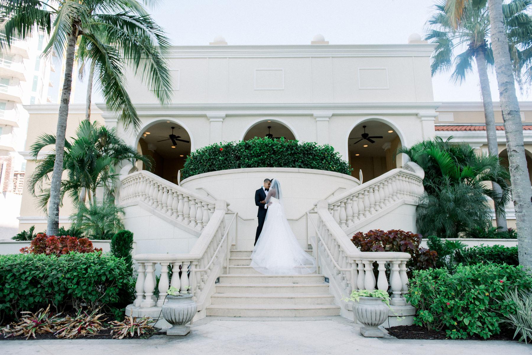 Classic Bride and Groom Wedding Portrait on Staircase of Hotel Wedding Venue Ritz Carlton Sarasota