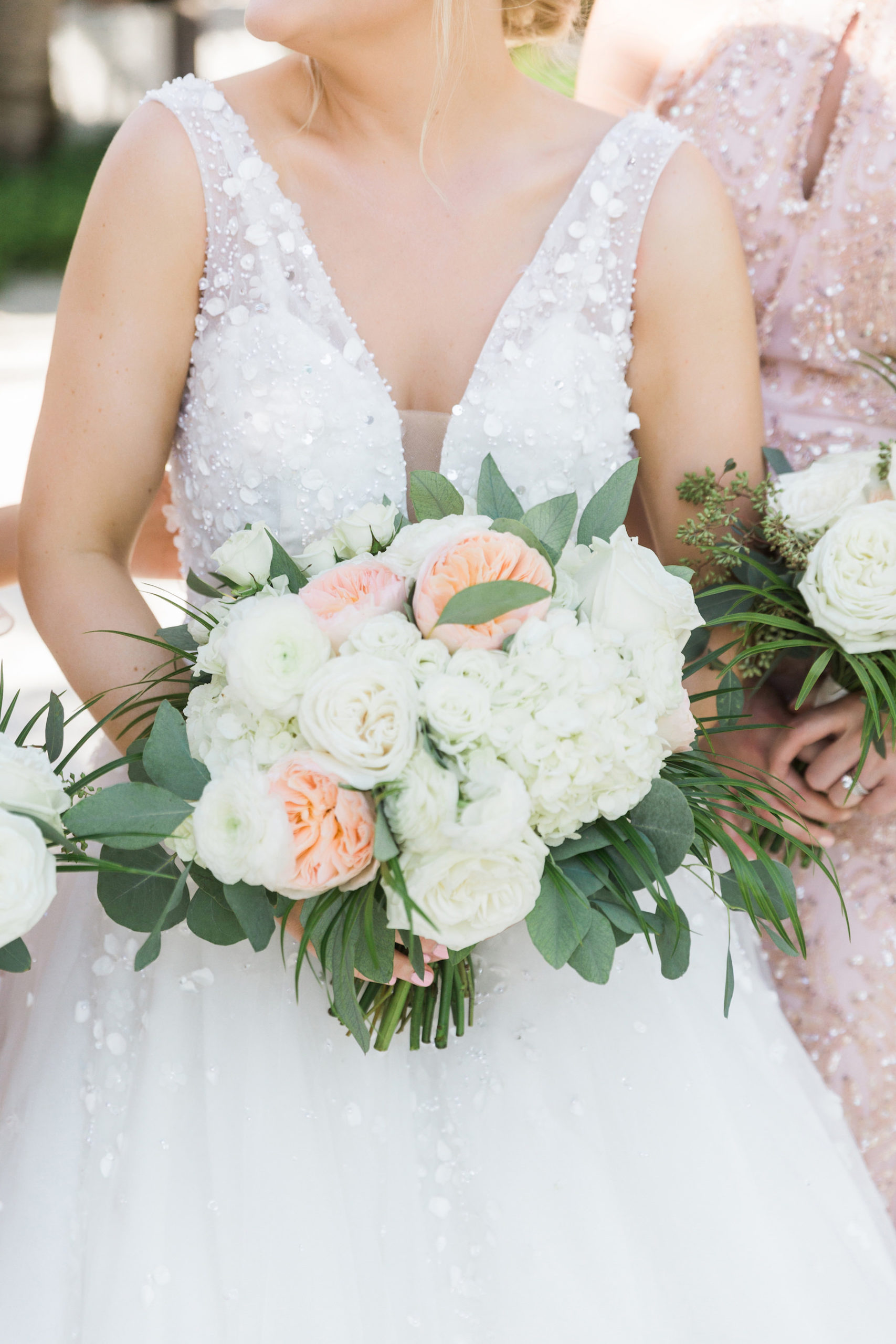 Nicole Spose A-Line Wedding Dress with Embellishments | Pastel White and Peach Bouquet