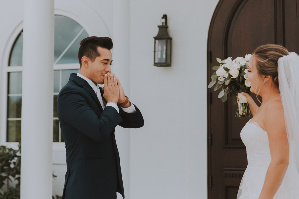 Bride and Groom First Look | Groom Classic Black Tux | Lace Wedding Gown with Long Cathedral Veil