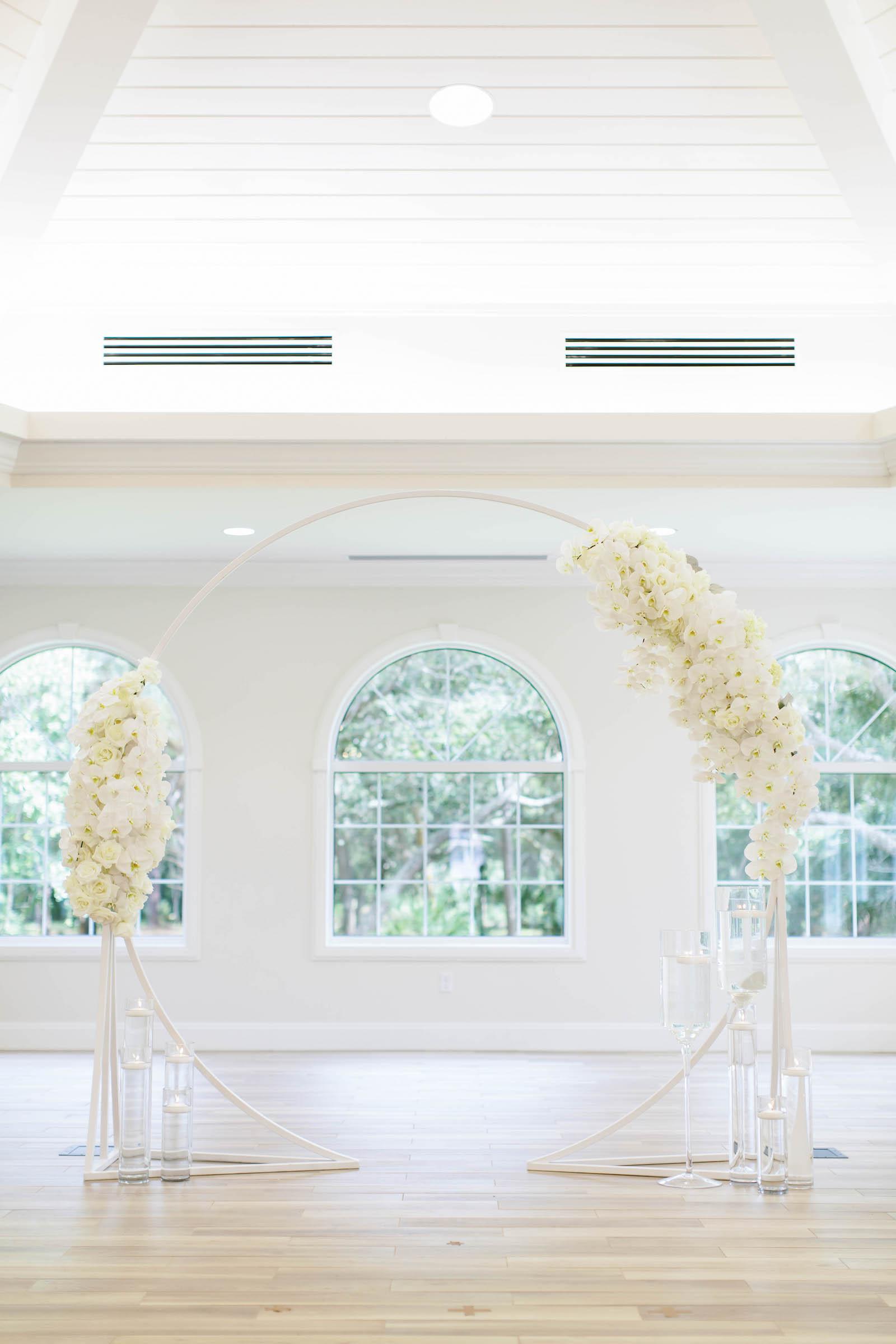 Classic Church Wedding Ceremony Decor, Circular Arch with White Floral Arrangements | Tampa Bay Wedding Planner Parties A'la Carte | Safety Harbor Wedding Venue Harborside Chapel