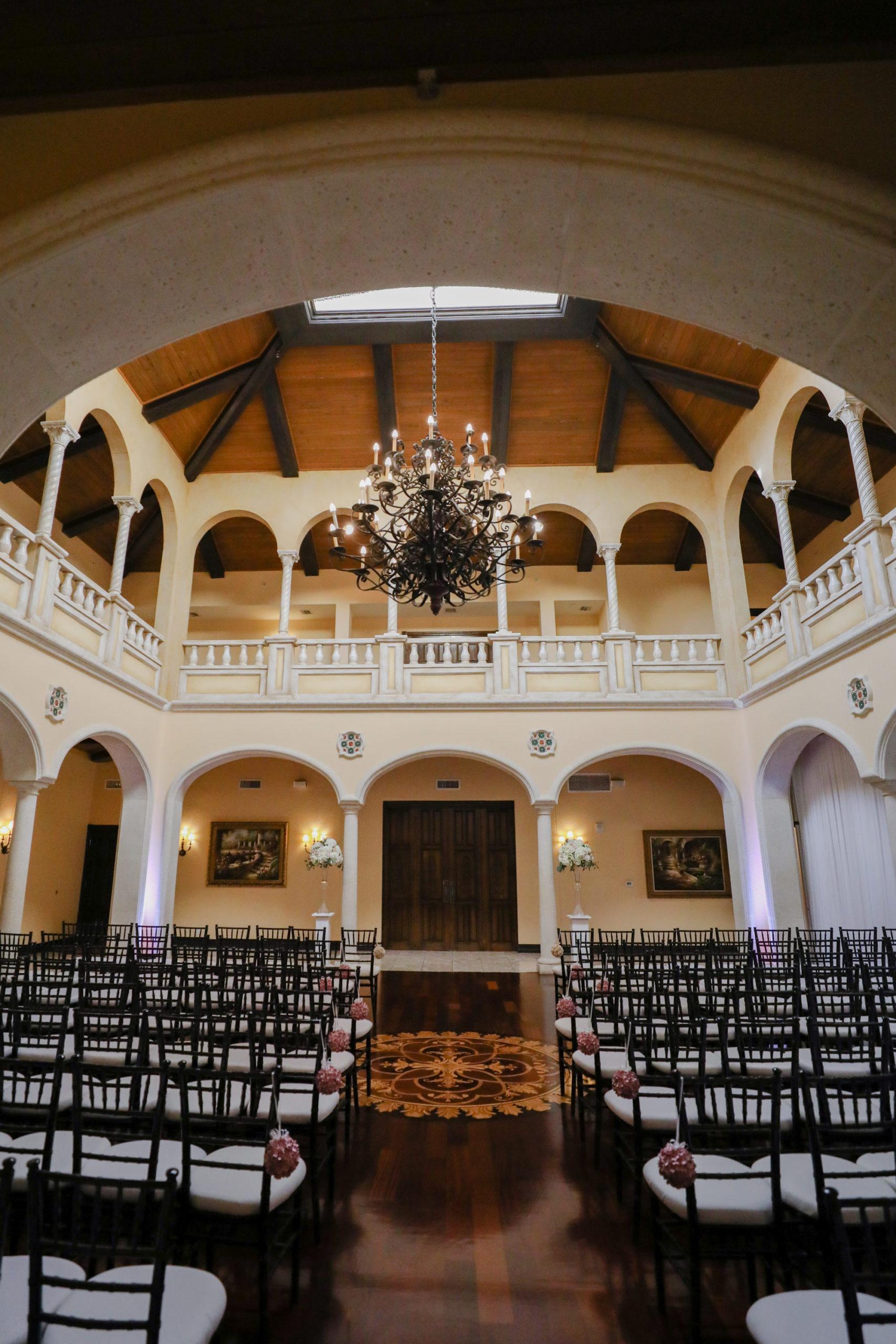 Indoor Ballroom Wedding Ceremony with Black Chiavari Chairs and Chandelier | Elegant Tampa Bay Wedding Venue Avila Golf & Country Club