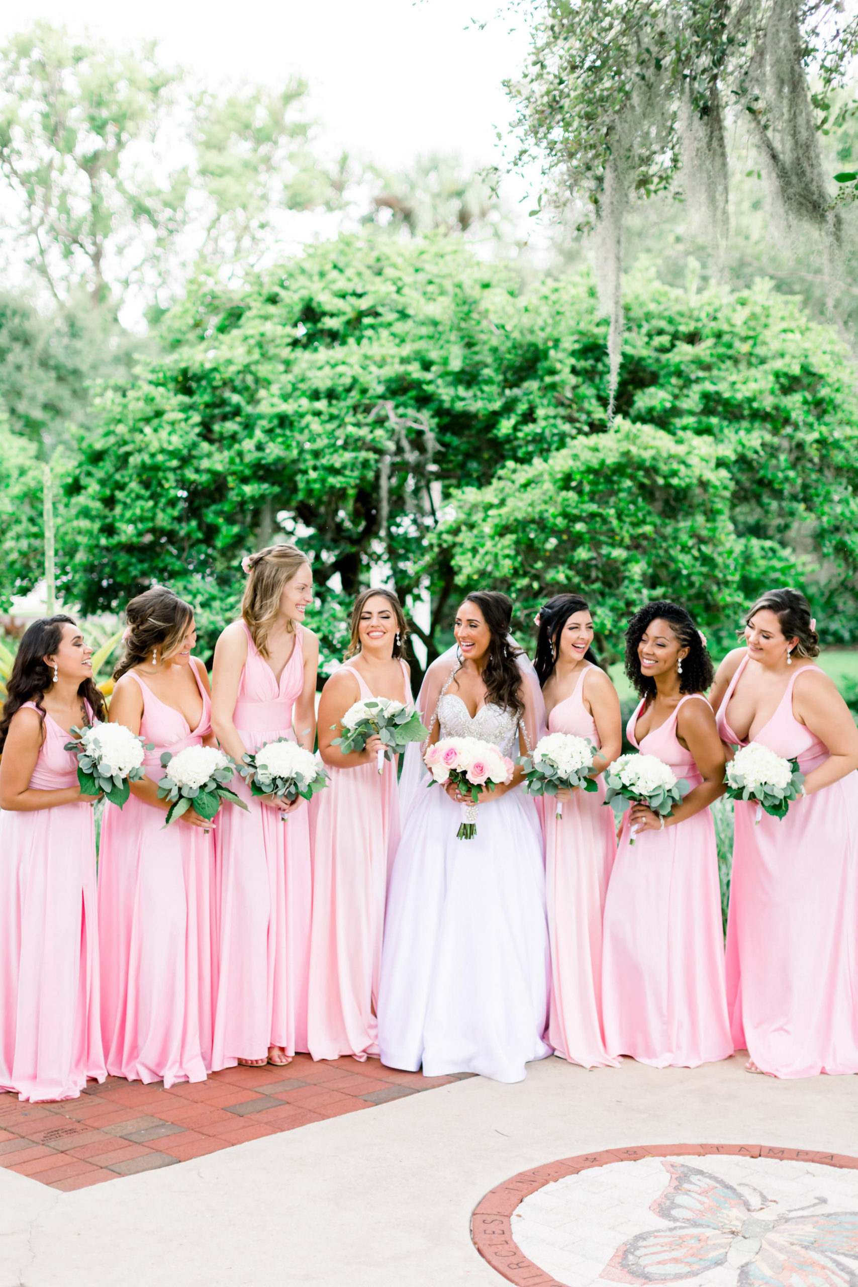 Florida Bride and Bridesmaids in Matching Pink Dresses Holding White and Pink Rose Floral Bouquets | Tampa Wedding Photographer Shauna and Jordon Photography | Wedding Dress Truly Forever Bridal