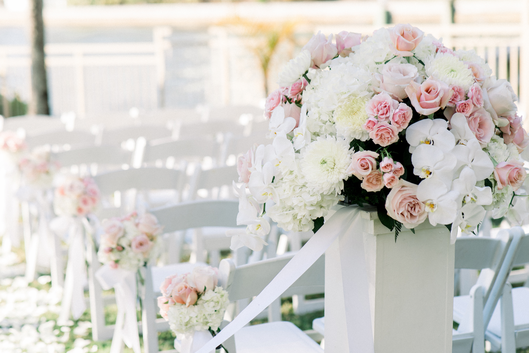Classic Elegant Wedding Ceremony Decor, White Pedestal with Blush Pink Roses, White Orchids and White Dahlia Floral Arrangement | Tampa Wedding Planner Special Moments Event Planning