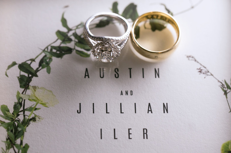 Round Solitaire Bride Diamond Engagement Ring with Halo Split Shank Band, Yellow Gold Groom Wedding Band on Greenery Custom Save the Date   Wedding Photographer Carrie Wildes Photography