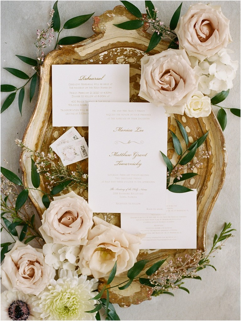 Tampa Wedding Stationery Suite Lay Flat Photo with Ornate Gold Tray and Champagne Rose Flowers | Classic Wedding Invitation with Gold Calligraphy