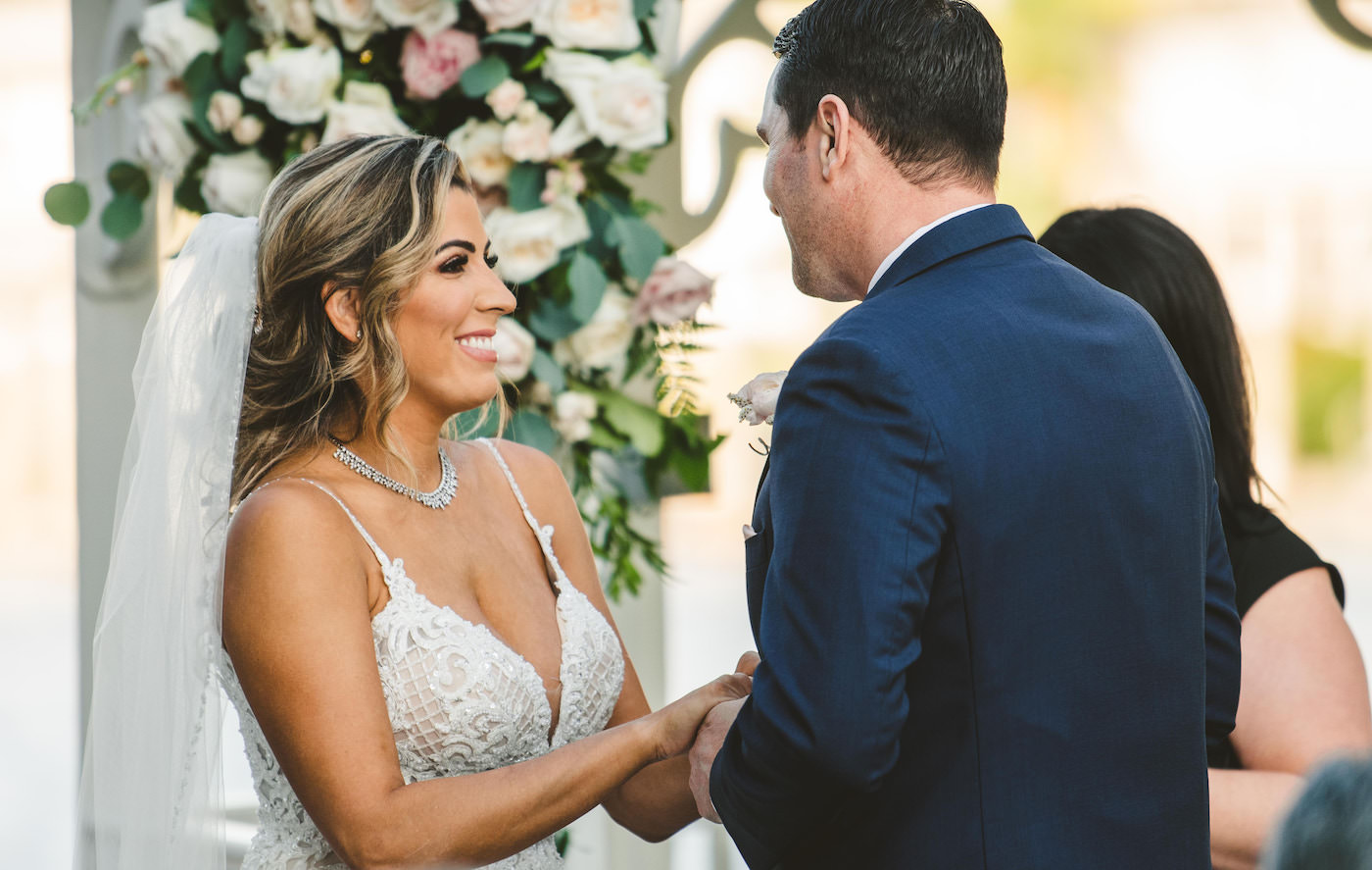 Bride and Groom Exchanging Vows during Outdoor Garden Ceremony | Champagne Illusion Lace V Neck Spaghetti Strap Wedding Dress Bridal Gown