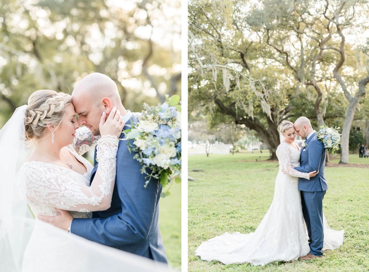 Bride and Groom Outdoor Garden Portraits   Ivory Lace Long Sleeve V Neck Bridal Gown and Groom in Blue Suit with Bow Tie   Blue and White Bridal Bouquet