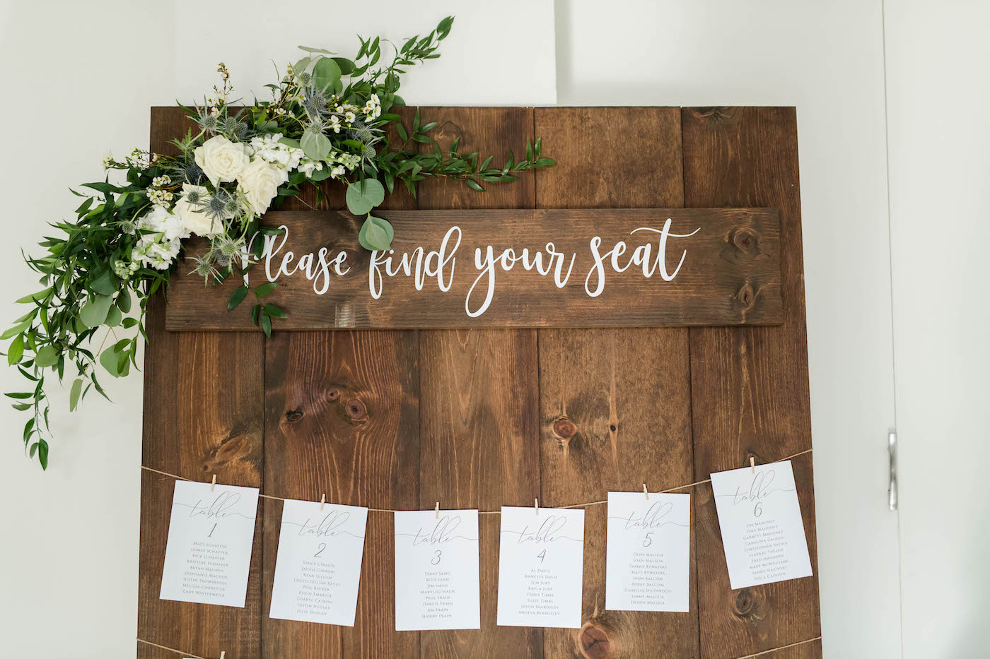 Wood Seating Chart with Table Cards and Greenery Floral Garland Spray