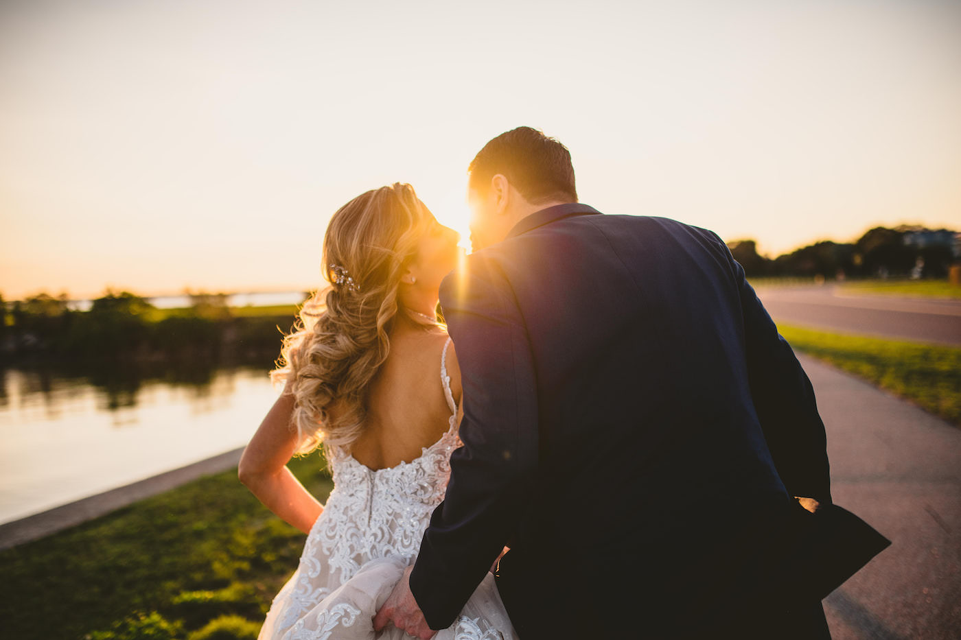 Tampa Waterfront Wedding Bride and Groom Sunset Portraits with Sunburst