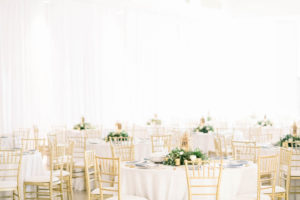 Tampa Wedding Venue the Tampa Garden Club Indoor Reception | Wedding Reception Tables with White Linens and Gold Chiavari Chairs and Low Greenery and Lantern Centerpieces | Gabro Event Services
