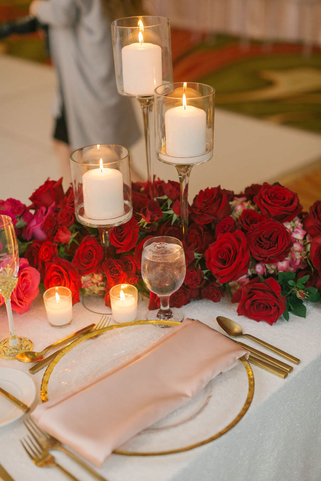 Romantic Wedding Reception Decor, Gold Rimmer Chargers and Flatware, Glass Candlesticks, Red Roses   Tampa Wedding Planner Parties A'la Carte   Wedding Florist Bruce Wayne Florals   Wedding Rentals A Chair Affair   Over the Top Rental Linens