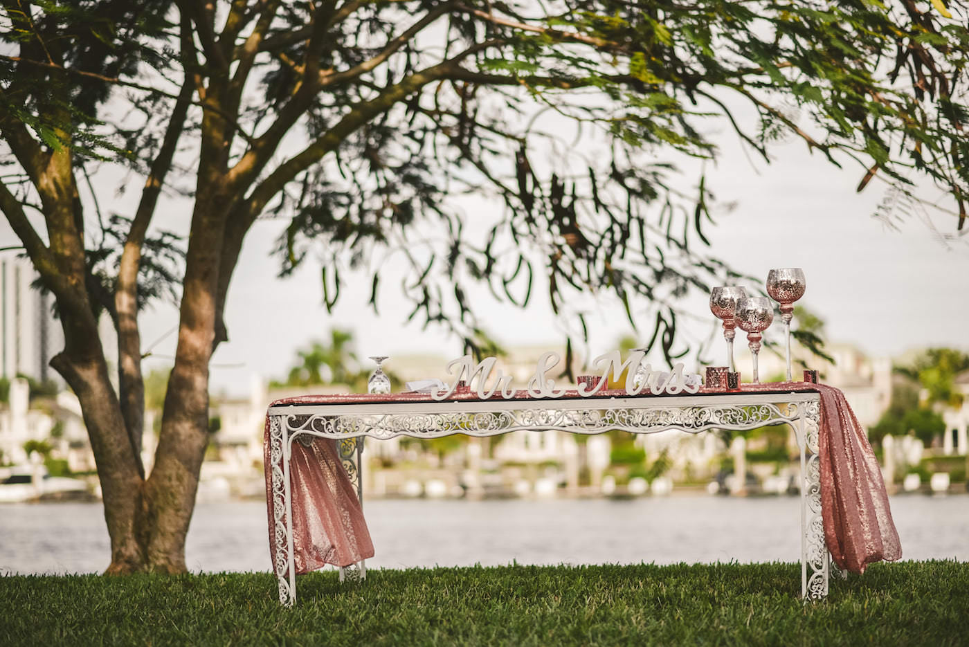 Tampa Outdoor Waterfront Garden Wedding Reception Sweetheart Table with Rose Gold Sequin Runner and Mr and Mrs Sign