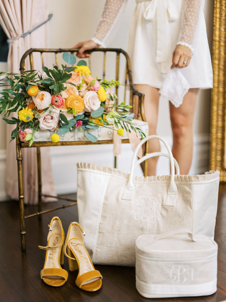 Elegant, Springtime Inspired Bridal Getting Ready Details, Monogram Bride Tote and Neutral Tone Makeup Bag, Mustard Open Toe Sam Edelman Yaro Block Heel Sandals, Romantic Bridal Bouquet with Vibrant Floral Stems, Pink Roses, Peach Carnations, Yellow Flowers, Soft Blue Accents | Florida Wedding Planner Kelly Kennedy Weddings and Events