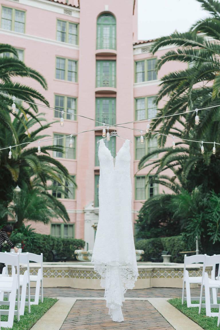 Lace Deep Plunging V Neckline Wedding Dress Hanging Off String Lights | St. Petersburg Hotel Wedding Venue Vinoy Renaissance