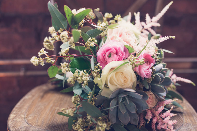 Bridal Wedding Bouquet with Dusty Rose Astilbe and Pink Ranunculus with White Roses and Succulents and Eucalyptus Greenery