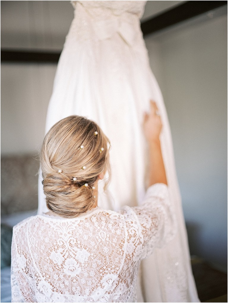 Bride Getting Ready | Chic Chignon Bun Bridal Hairstyle with Pearl Pins | St. Pete Wedding Hair and Makeup Femme Akoi Beauty Studio