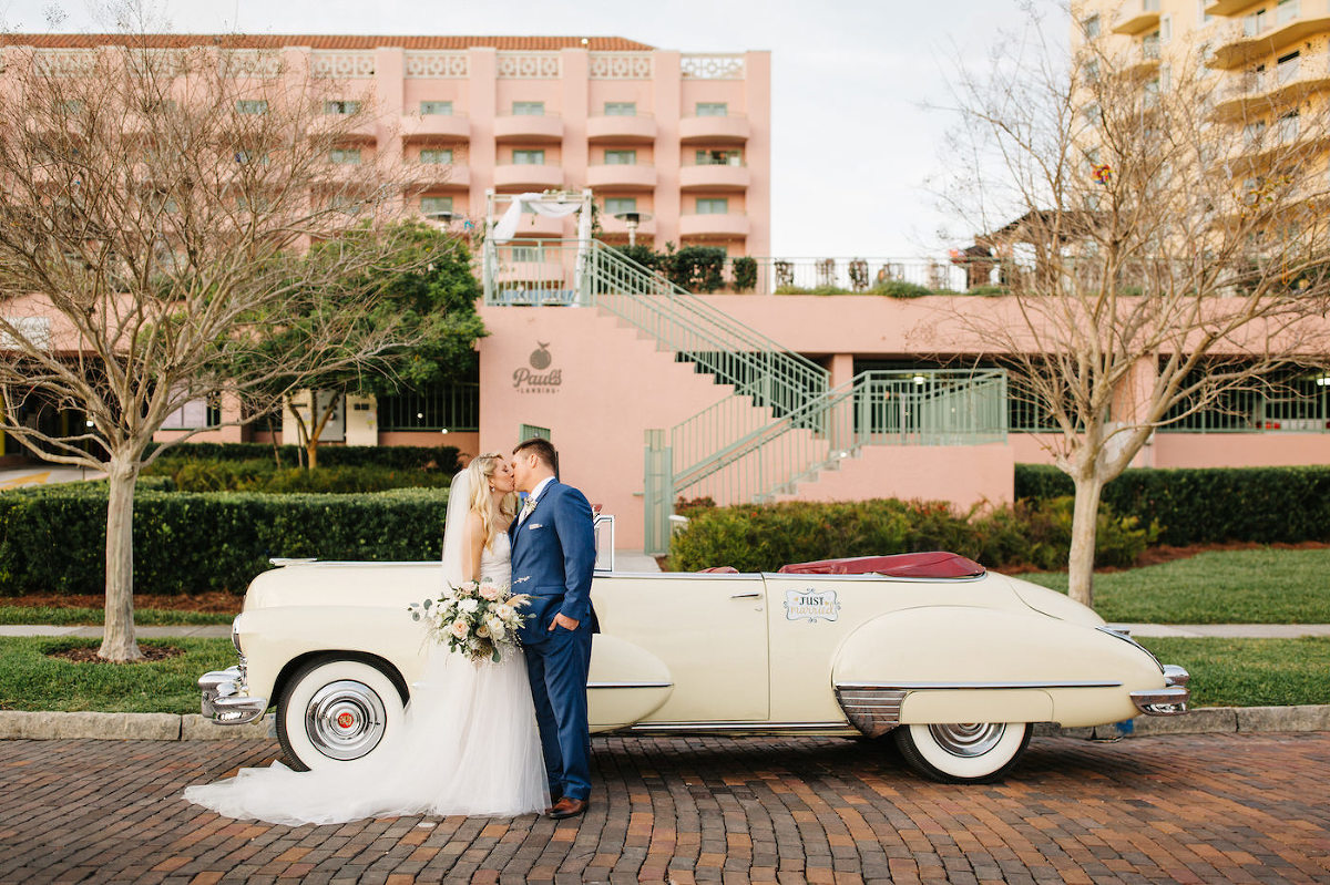 Florida Bride and Groom Wedding Portrait in Front of Vintage White Car | Ashley Stegbauer Morrison Wearing Boho Chic Inspired Ines Di Santo Wedding Dress| Tampa Bay Historic Wedding Venue The Vinoy Renaissance Resort | Downtown St. Pete Wedding Planner Parties A' La Carte | Wedding Dress Shop Isabel O'Neil Bridal Collection