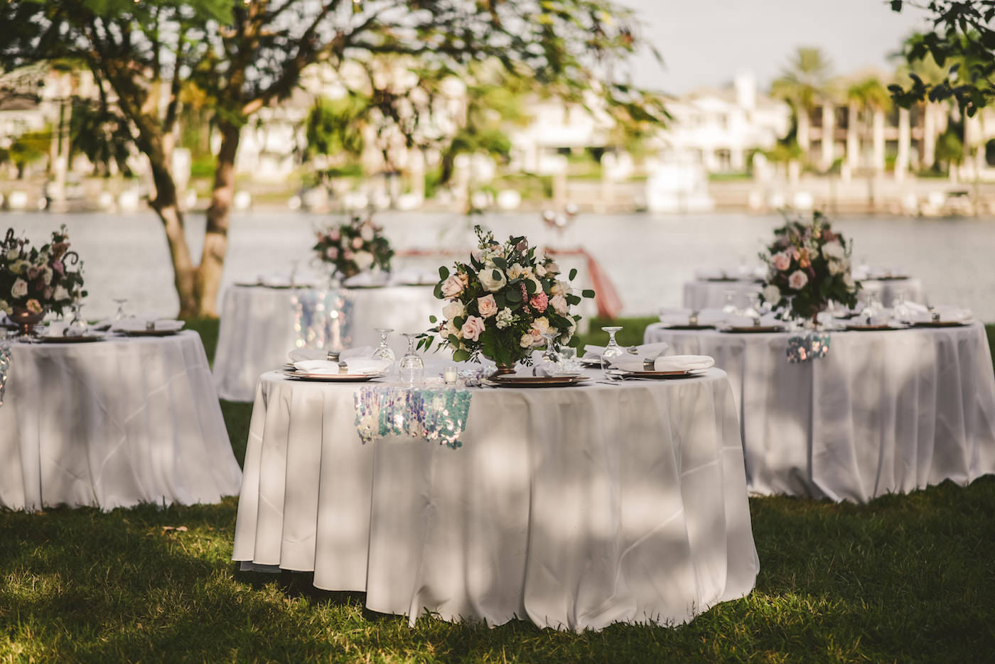 Tampa Outdoor Waterfront Garden Wedding Reception Guest Tables with Sequin Runners and Blush Pink and White Rose Centerpieces with Eucalyptus Greenery | Elite Events Catering