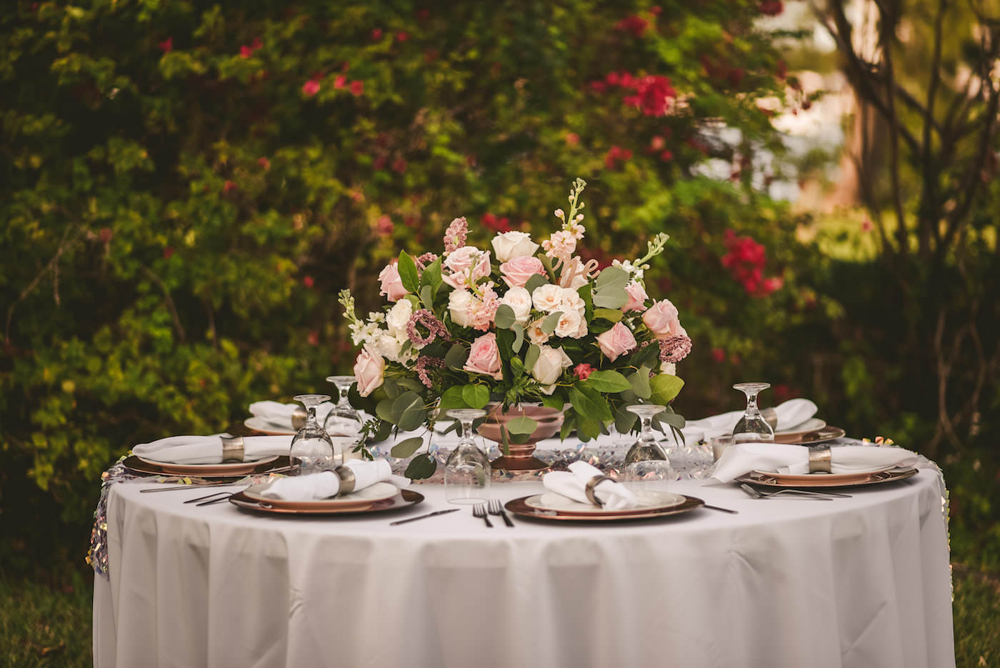 Tampa Outdoor Waterfront Garden Wedding Reception Guest Tables with Sequin Runners and Blush Pink and White Rose Centerpieces with Eucalyptus Greenery and Gold Charger Plates