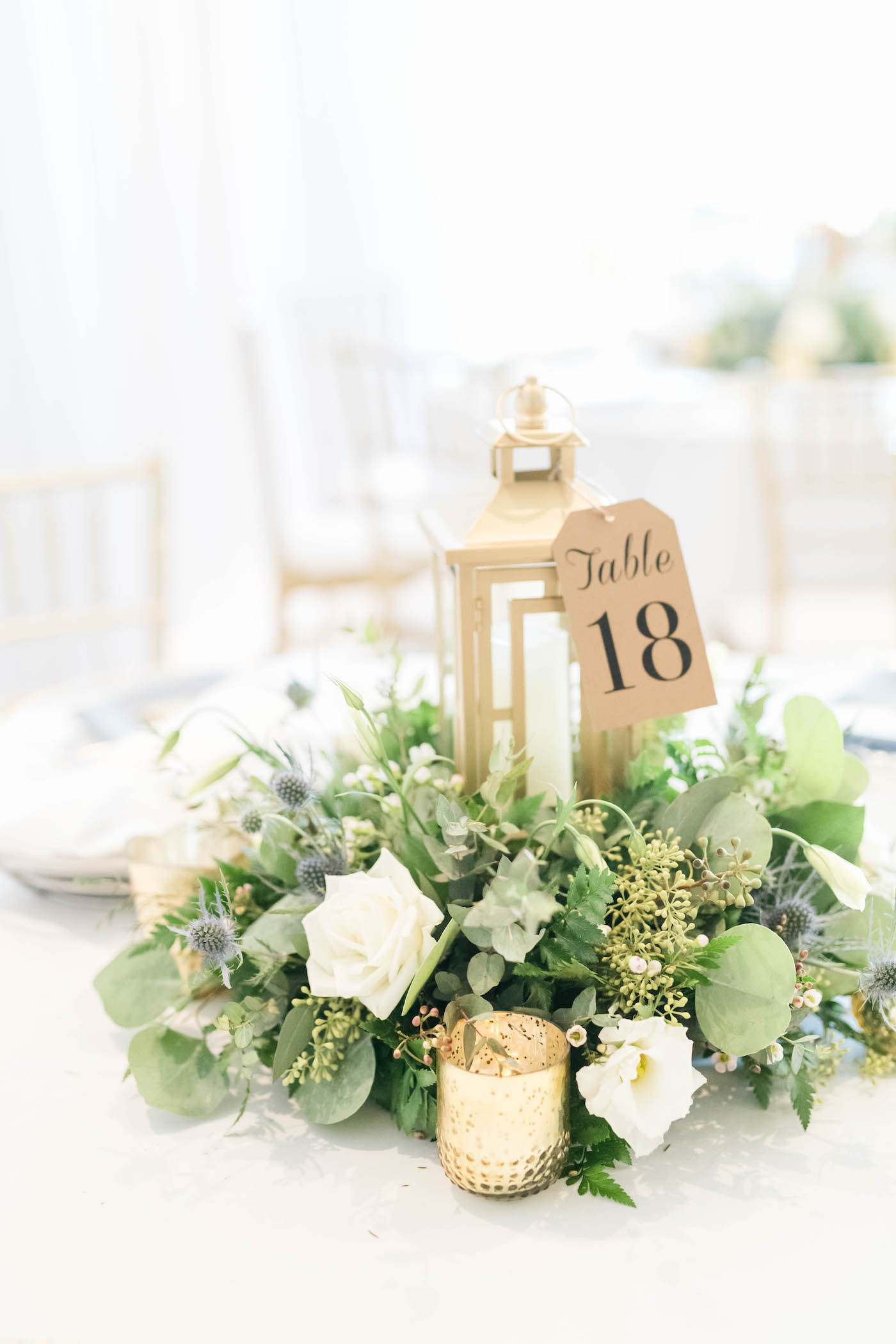 Wedding Centerpiece with Lantern and Greenery with Gold Votive Candles and Kraft Paper Table Number Tag