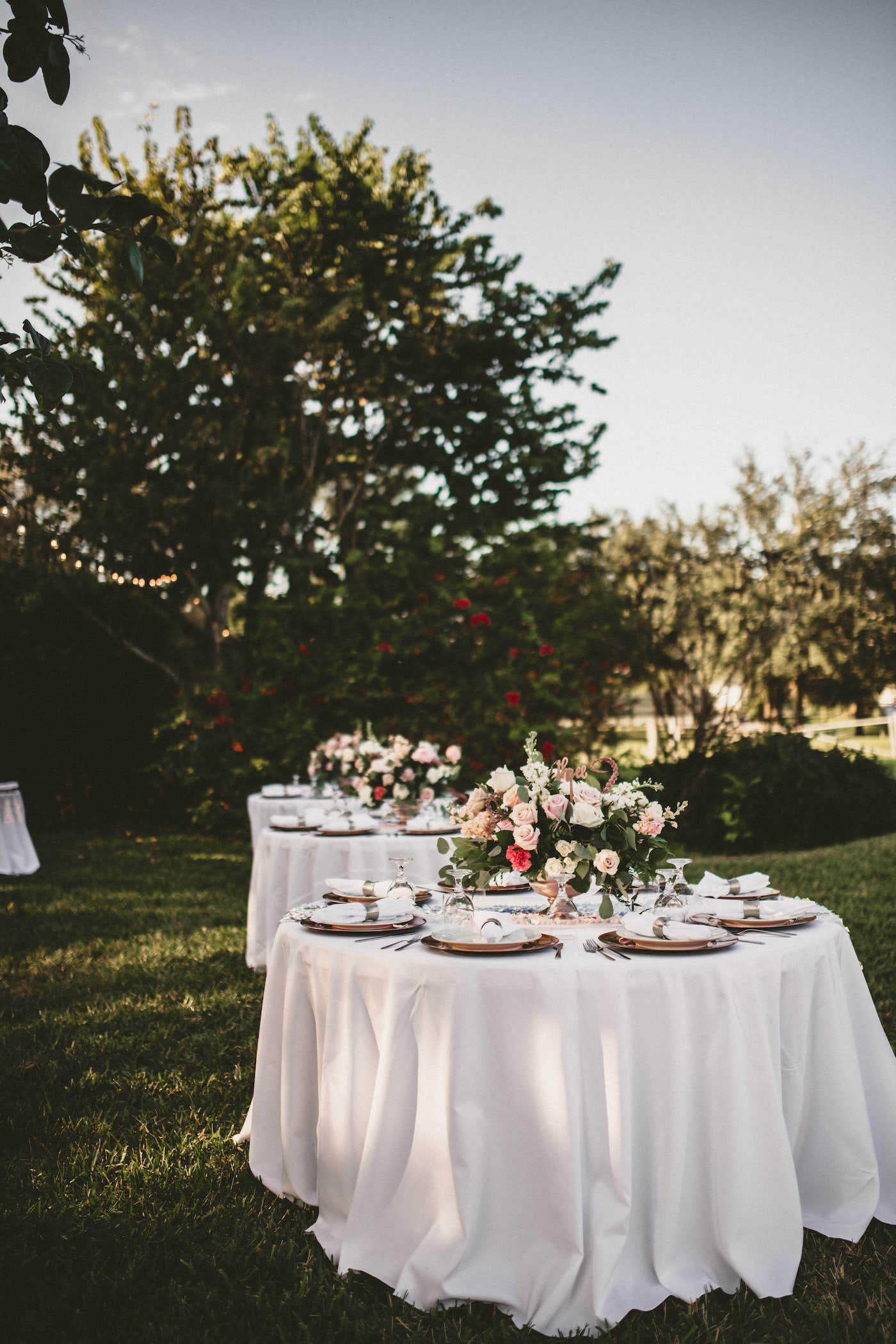 Tampa Outdoor Waterfront Garden Wedding Reception Guest Tables with Sequin Runners and Blush Pink and White Rose Centerpieces with Eucalyptus Greenery and Gold Charger Plates | Elite Events Catering