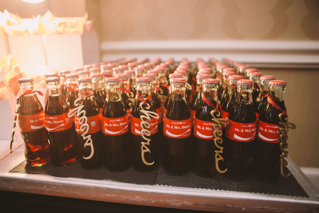 Custom Coca Cola Wedding Favor Bottles with Laser cut Gold Cheers Sign   Wedding Bars and Barback Kate Ryan Event Rentals   Tampa Wedding Planner Parties A'la Carte