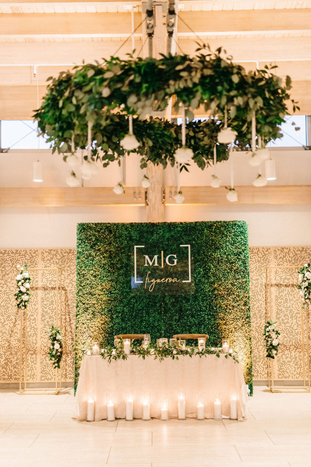 Luxurious, Elegant Wedding Reception and Decor, Sweetheart Table at Garden Inspired Wedding Reception, Suspended Hanging White Rose Floral Arrangement, Greenery Boxwood Wall with Custom Gold Initials, Gold Draping | Downtown Tampa Wedding Planner UNIQUE Weddings and Events | Florida Special Event Rental Company Over The Top Linens | Tampa Bay Decor Rental A Chair Affair