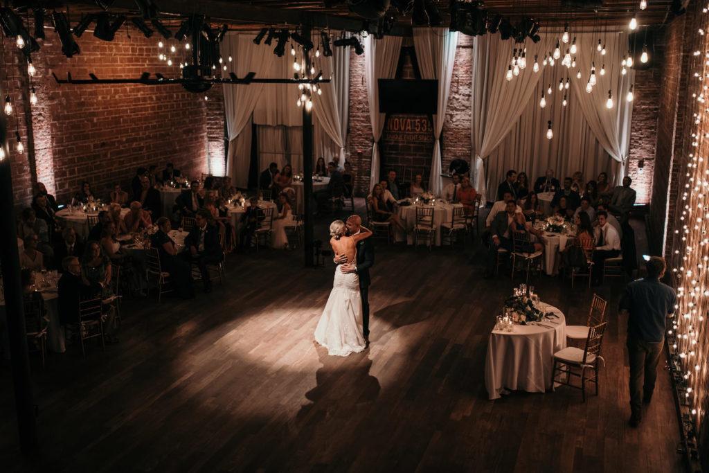 Downtown St. Petersburg Bride and Groom Share Romantic First Dance Wedding Reception Portrait | Historic Florida Wedding Venue NOVA 535
