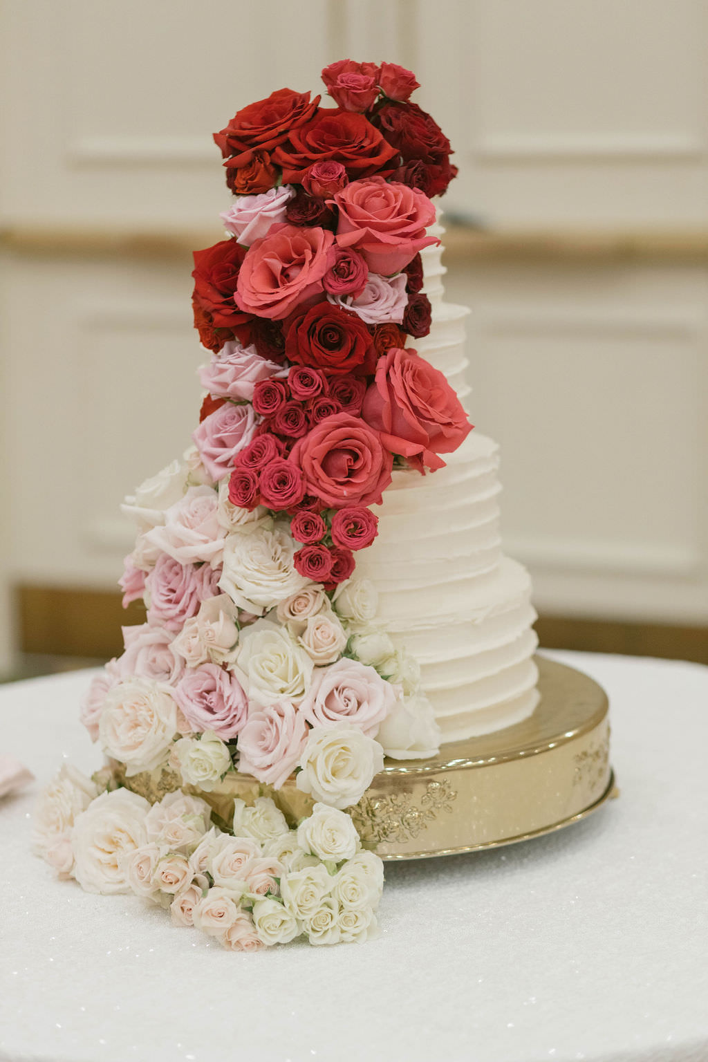 Classic White Ruffled Wedding Cake with Red, Pink, Blush, and Ivory Cascading Roses   Tampa Bay Wedding Planner Parties A'la Carte   Wedding Florist Bruce Wayne Florals