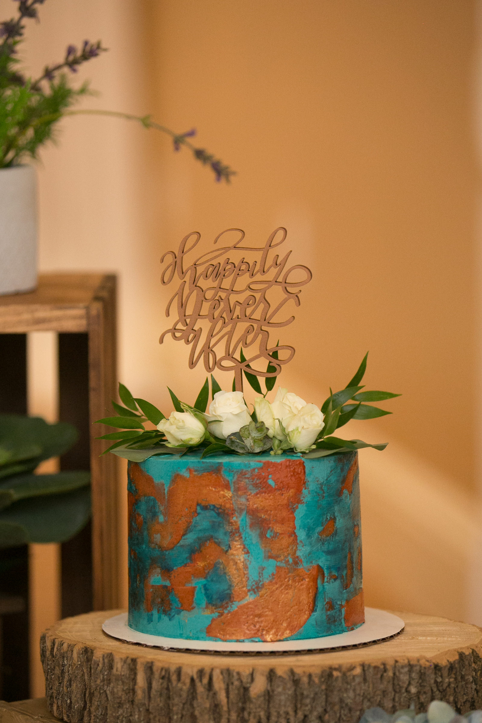 Unique One Tier Blue Teal Patina and Copper Painted Wedding Cake with White Roses and Greenery and Laser Cut Custom Cake Topper | Wedding Photographer Carrie Wildes Photography