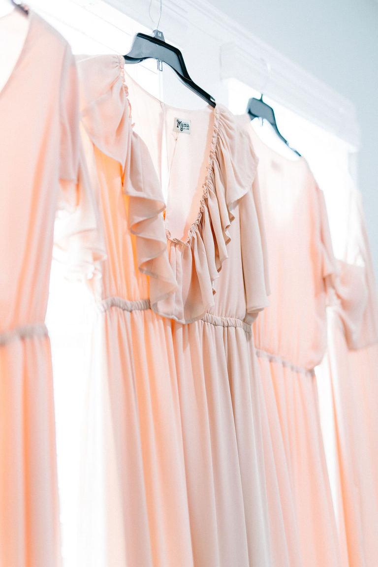 Tampa Bay Bridesmaid Dress Handing in Window, Blush Pink Show Me Your Mumu Wedding Bridal Party Attire