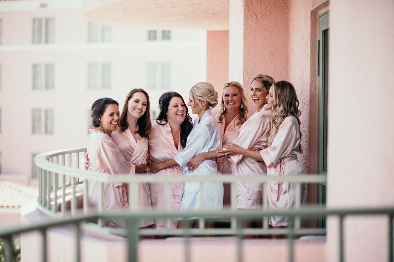 Florida Bride and Bridesmaids Getting Ready Photo on Balcony of The Vinoy Renaissance Hotel in Downtown St. Petersburg, Bridesmaids in Matching Blush Pink Silk Robes